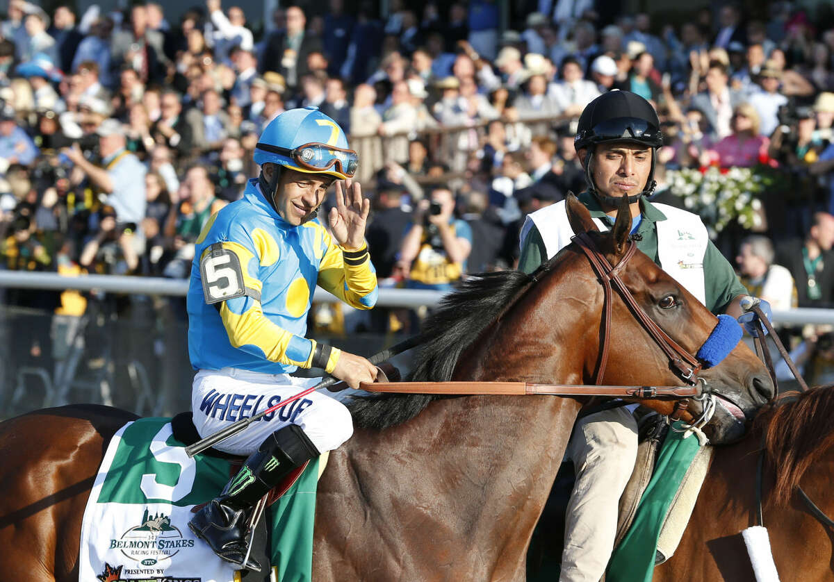 American Pharoah (5) with Victor Espinoza up parades to the starting gate before the 147th running of the Belmont Stakes horse race at Belmont Park, Saturday, June 6, 2015, in Elmont, N.Y. (AP Photo/Julio Cortez)