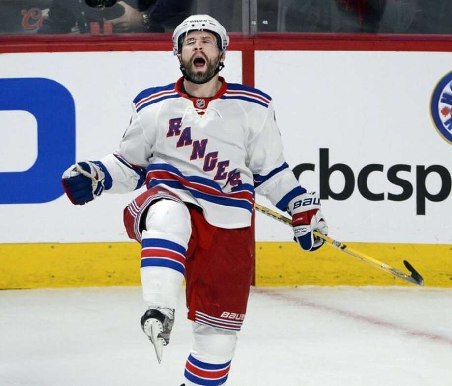 New York Rangers right wing Martin St. Louis celebrates after scoring a goal against the Montreal Canadiens during the first period in Game 1 of the Eastern Conference finals in the NHL hockey Stanley Cup playoffs in Montreal on Saturday, May 17, 2014. (AP Photo/The Canadian Press, Ryan Remiorz)