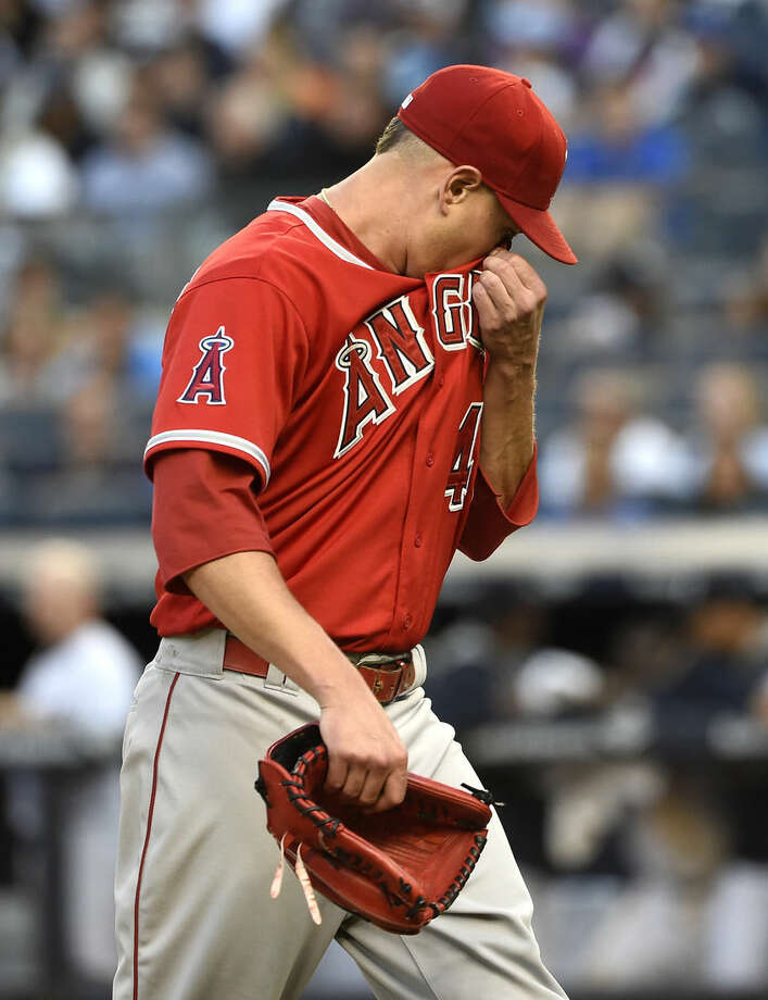 Los Angeles Angels starting pitcher Garrett Richards (43) reacts as he walks to the dugout after being taken out of the baseball game by manager Mike Scioscia in the first inning of a baseball game at Yankee Stadium on Saturday, June 6, 2015, in New York. Richards gave up six runs in the first inning. (AP Photo/Kathy Kmonicek)