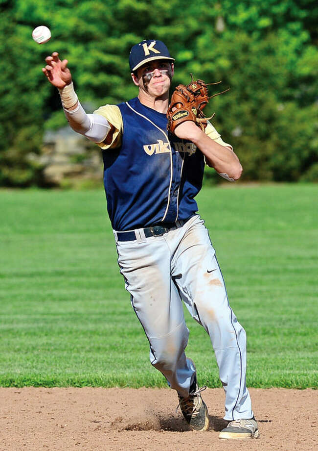 Hour photo / Erik Trautmann King's Dan Rominello throws out a runner during their FAAchampionship game against Rye Country Day Saturday.