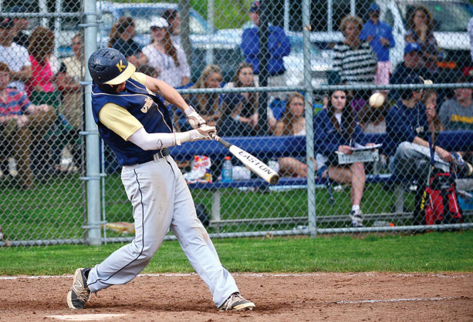 Hour photo / Erik Trautmann King's Dan Rominello hits another RBI during their FAAchampionship game against Rye Country Day Saturday.