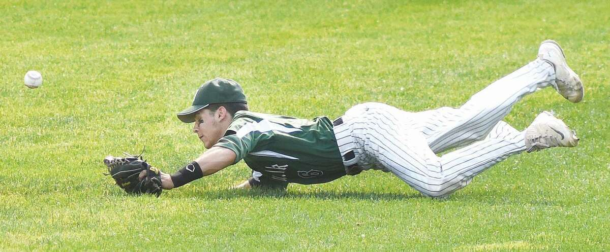 Hour photo/John Nash - Norwalk's Reid Singewald can't come up with a diving catch during Wednesday's CIAC Class LL semifinal game at Muzzy Field in Bristol. Staples defeated Norwalk, 11-0.