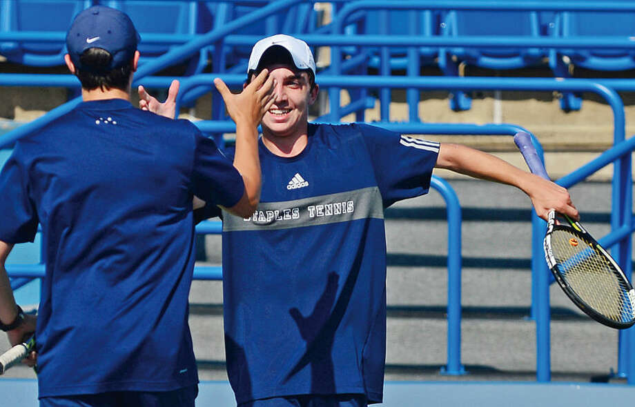 Hour photo / Erik Trautmann Staples High School's Josh Moskovitz celebrates with teammate Max Zimmerman after winning the state tournament boys doubles tennis title at Yale in New Haven Wednesday.