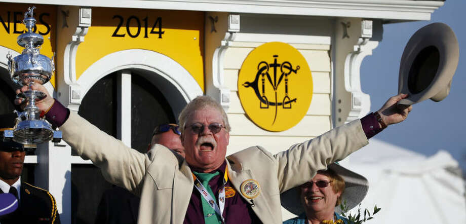 Co-owner Steven Coburn celebrates in the winner's circle after California Chrome won the 139th Preakness Stakes horse race at Pimlico Race Course, Saturday, May 17, 2014, in Baltimore. (AP Photo/Matt Slocum)