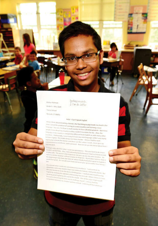 Hour photo / Erik Trautmann Mahuir Rahman, a fifth grader at Tracey Elementary School was selected as second prize winner in the national Breaking Barriers Essay Contest, sponsored by Scholastic and Major League Baseball. The contest is dedicated to the memory of Jackie Robinson.