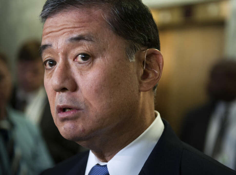 In this May 15, 2014, photo, Veterans Affairs Secretary Eric Shinseki speaks with the news media on Capitol Hill in Washington. Shinseki would be granted more authority to fire or demote senior executives under a bill headed to the House floor. The measure comes as pressure builds on Capitol Hill to overhaul the beleaguered agency in response to allegations of treatment delays and preventable deaths. (AP Photo/Cliff Owen)