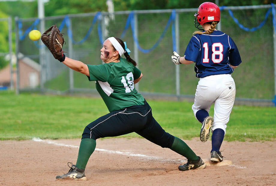 Hour photo / Erik Trautmann Mallory Rochefort of Norwalk High gets a late throw as Senator Sam Ruess crosses the bag in their intracity softball game against Brien Mcmahon Wednesday