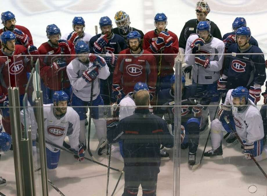 Montreal Canadiens head coach Michel Therrien speaks to his players during the team's practice Wednesday, May 21, 2014 in Brossard, Quebec. The Canadiens play the New York Rangers in Game 3 of the Eastern Conference final of the Stanley Cup Playoffs on Thursday in New York. (AP Photo/The Canadian Press, Ryan Remiorz)