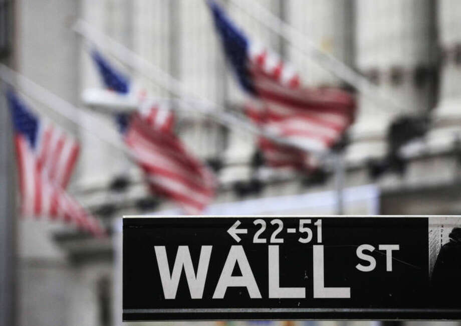 FILE - This April 22, 2010, file photo, shows a Wall Street sign in front of the New York Stock Exchange. U.S. stocks slumped Thursday, July 31, 2014, as investors reacted to disappointing corporate earnings reports and assessed the implications of the approaching end to economic stimulus from the Federal Reserve. (AP Photo/Mark Lennihan, File)