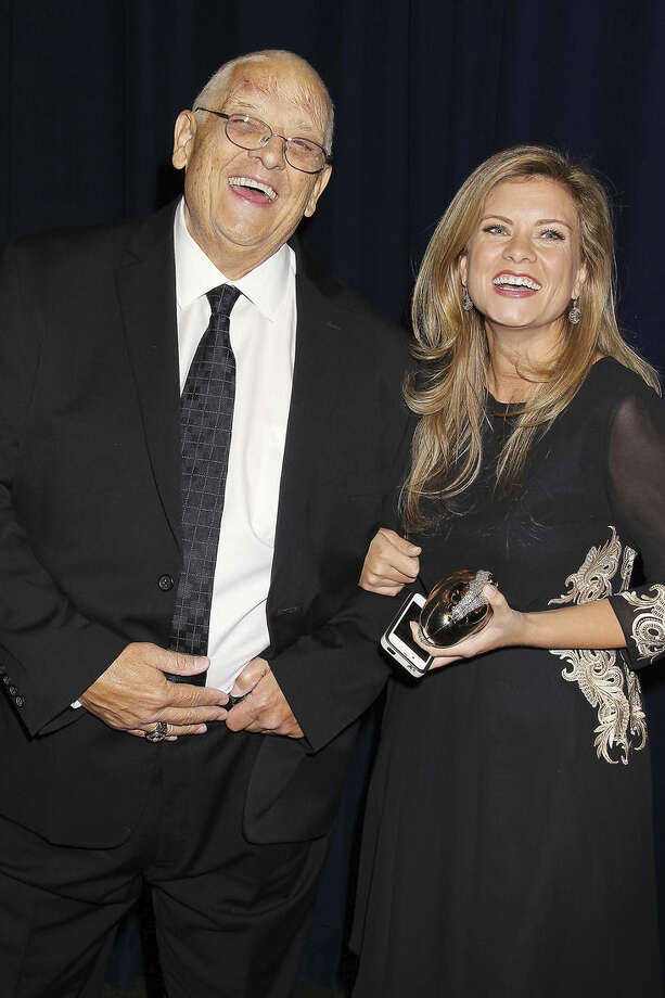 In this Nov. 13, 2014 photo released by Starpix, WWE wrestler Dusty Rhodes, left, whose real name is Virgil Runnels, poses with his daughter Kristin Ditto at the Joe Torre Safe at Home Foundations 12th Annual Gala in New York. The WWE said Runnels died Thursday, June 11, 2015, but a spokesman declined to say where or how he passed away, saying the family had not authorized the release of that information. He was 69. (Dave Allocca/Starpix via AP)