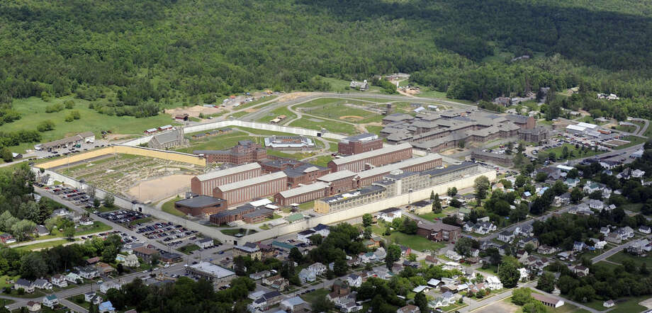 This aerial photo shows the Clinton Correctional Facility on Thursday, June 11, 2015 in Dannemora, N.Y. Police continue to search for David Sweat, 34, and Richard Matt, two escaped inmates from the correctional facility. Schools were closed, and residents received automated calls warning them to lock their doors, close their windows and leave outside lights on. (AP Photo/Tim Roske)