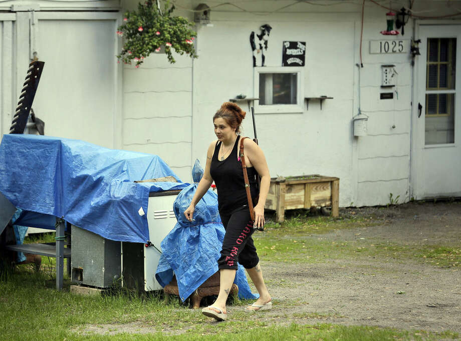 Jennifer Hilchey-Reyell carries a .22 rifle as she walks to her house next door near Dannemora, N.Y., Thursday, June 11, 2015. Hilchey-Reyell has been keeping a gun close at hand since the escape of two prisoners from the maximum-security Clinton Correctional Facility near her home. (AP Photo/Seth Wenig)