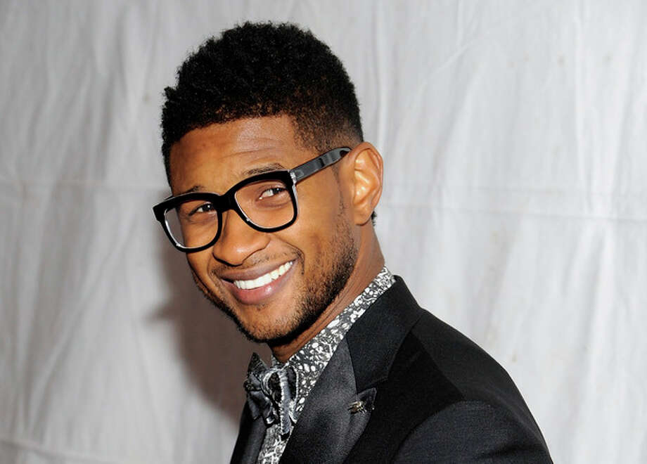 "FILE - This Nov. 17, 2011 file photo shows singer Usher Raymond at the ""Pencils Of Promise"" inaugural gala in New York. The Grammy-winning singer is collaborating with Macy's to curate the concept, music and design behind the company's annual July 4 fireworks extravaganza. Macy's said Thursday, May 9, 2013, it's the first time the company has worked with an artist on the concept. (AP Photo/Evan Agostini, file) / AGOEV"