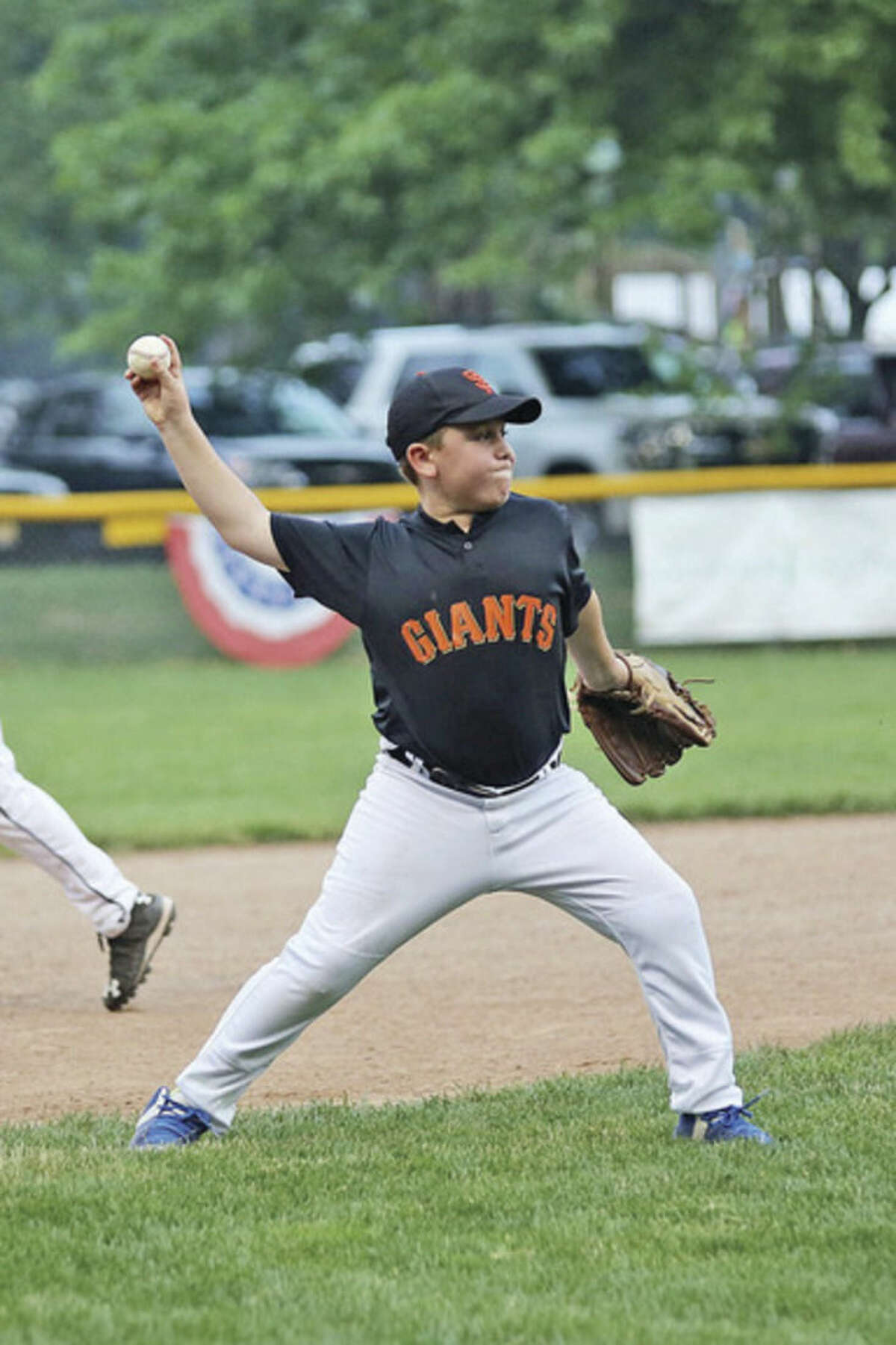 Hour photo/Danielle Calloway Mickey Wilcox of the Giants makes a play at third base during the Wilton Little League Majors Division Championship game against the Astros Thursday evening at Bill Terry Field in Wilton.