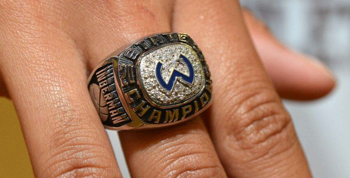 Members of the Wilton girls basketball team get their championship rings.