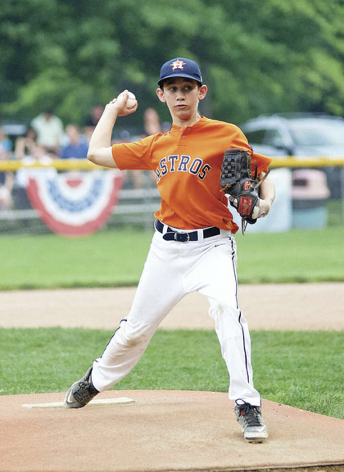 Hour photo/Danielle Calloway Astros pitcher Andrew Travers about to throw a strike during the Wilton Little League Majors Division Championship game against the Giants on Thursday evening at Bill Terry Field in Wilton.