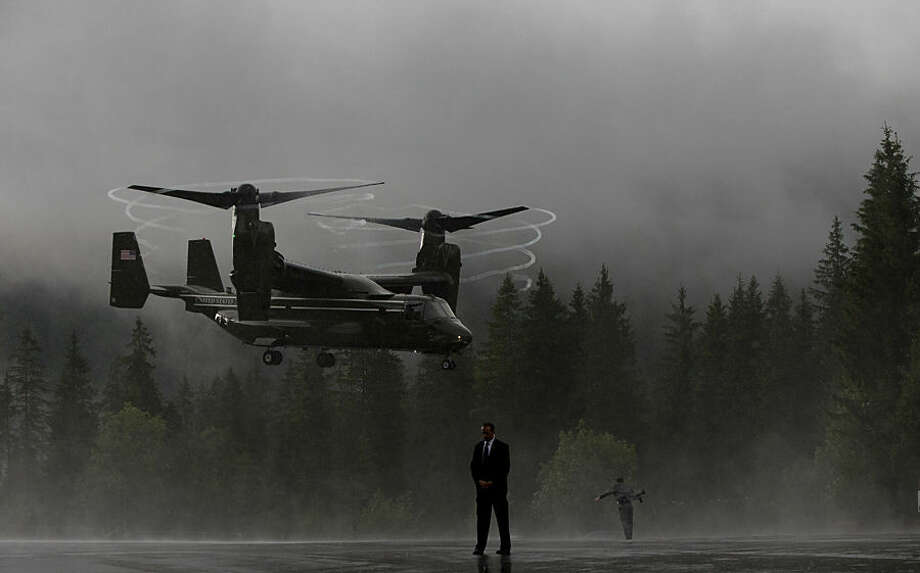 An osprey helicopter lands in the rain near Schloss Elmau hotel near Garmisch-Partenkirchen, southern Germany, Monday, June 8, 2015, to transport delegation members traveling with U.S. President Barack Obama from the G-7 Summit, to Munich airport en rout to Washington. (AP Photo/Carolyn Kaster)