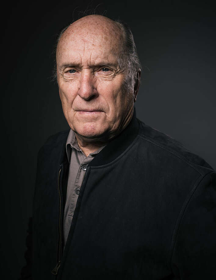 "In this Friday, June 5, 2015 photo, Robert Duvall poses for a portrait during an interview in Los Angeles. The actor is promoting his new film, ""Wild Horses,"" released now in U.S. theaters. (Photo by Casey Curry/Invision/AP)"