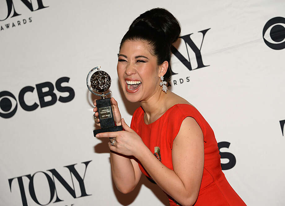 "Ruthie Ann Miles poses with the award for best performance by an actress in a featured role in a musical for ""The King & I"" in the press room at the 69th annual Tony Awards at Radio City Music Hall on Sunday, June 7, 2015, in New York. (Photo by Evan Agostini/Invision/AP)"