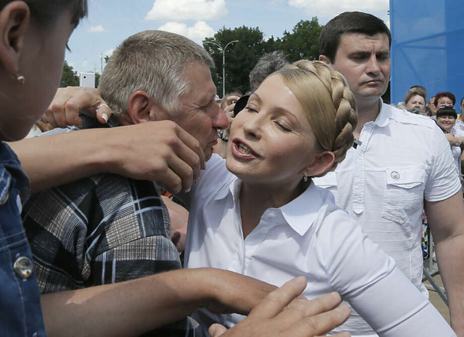 Ukrainian presidential candidate Yulia Tymoshenko is welcomed by her supporters during a rally in Priluki, Ukraine, Thursday, May 22, 2014. The presidential election vote in Ukraine is scheduled for Sunday May 25. (AP Photo/Efrem Lukatsky)