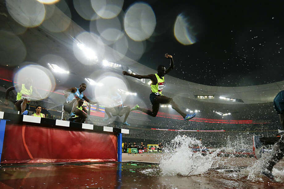 Athletes compete in the men's 3000m steeplechase at the 2014 IAAF World Challenge Beijing held at China's National Stadium in Beijing, Wednesday, May 21, 2014. (AP Photo/Alexander F. Yuan)
