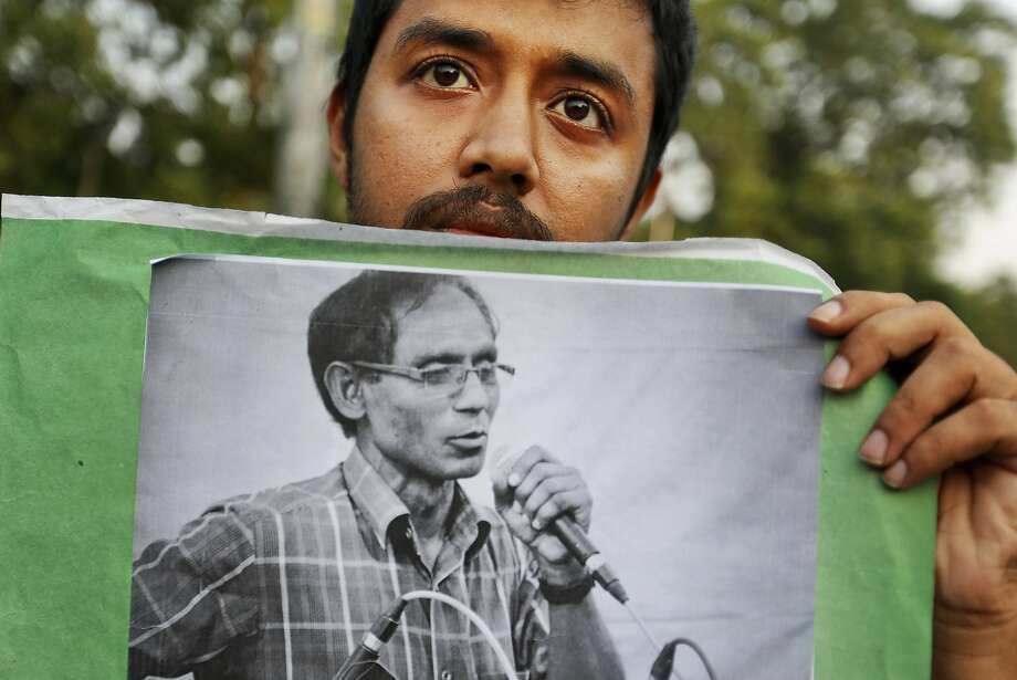 A student holds a picture of Professor A.F.M. Rezaul Karim Siddique during a protest in April against his killing in Dhaka, Bangladesh. Photo: Associated Press