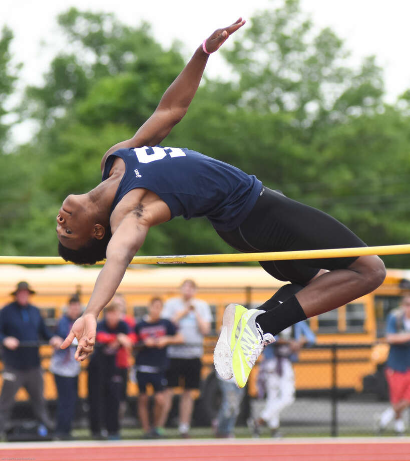 Hour photo/John Nash - Action from Monday's State Open track and field championship at Willow Brook Park in New Britain.