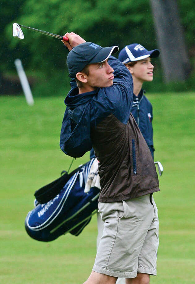 Hour photo / Erik Trautmann Wilton High's Sam Marsh hits onto the first green during the Chappa Golf Tournament at Longshore park in Westport Thursday.