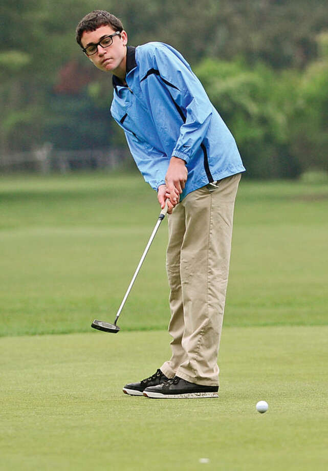 Hour photo / Erik Trautmann Brien McMahon's Miles McQuillen putts on the first green during the Chappa Golf Tournament at Longshore park in Westport Thursday.