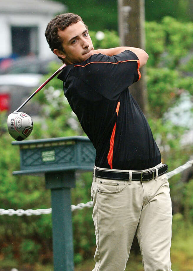 Hour photo / Erik Trautmann Stamford High's Sam Massa hits off the first tee during the Chappa Golf Tournament at Longshore park in Westport Thursday.