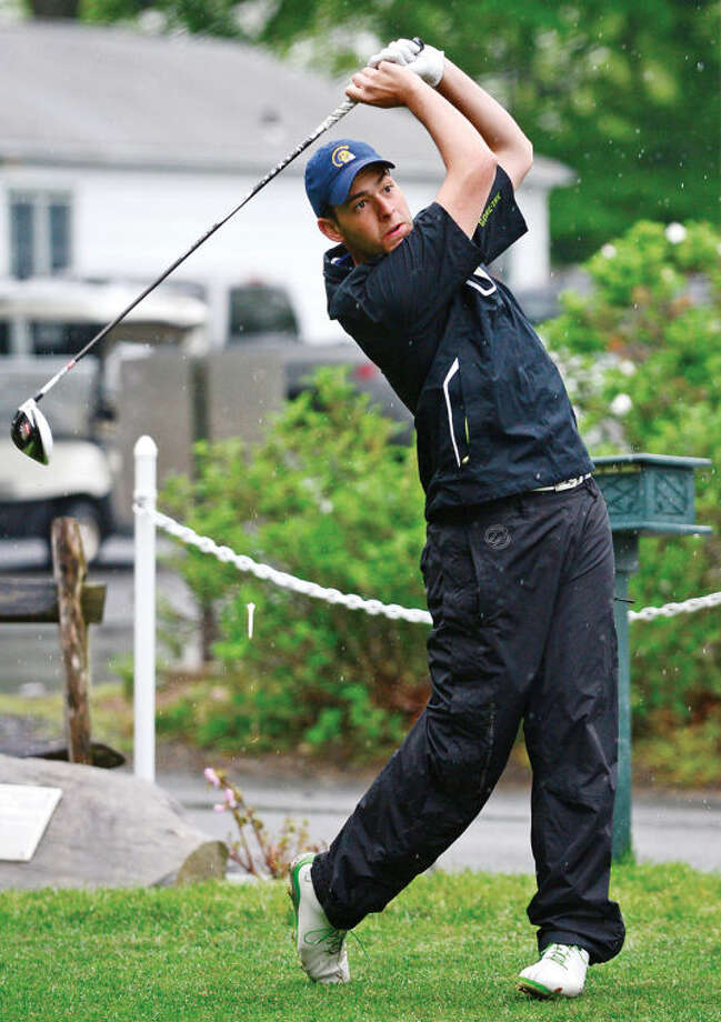 Hour photo / Erik Trautmann Weston's Asher Geenberg hits off the first tee during the Chappa Golf Tournament at Longshore park in Westport Thursday.