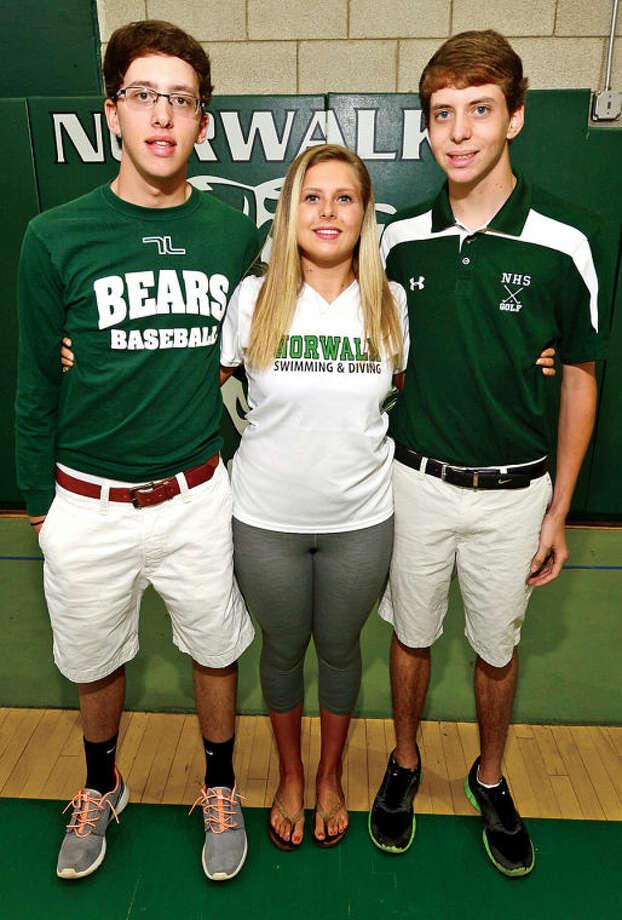 Hour photo / Erik Trautmann Thomas, Sarah and James Henderson. Triplets who all play sports at Norwalk High School.