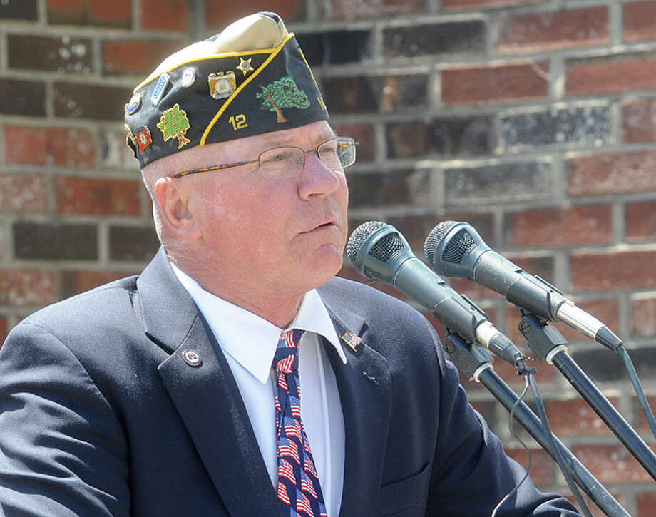 Buddy Scudder speaks at the Shea-Magrath Memorial Ceremony Sunday at Calf Pasture Beach in Norwalk. Hour photo/Matthew Vinci