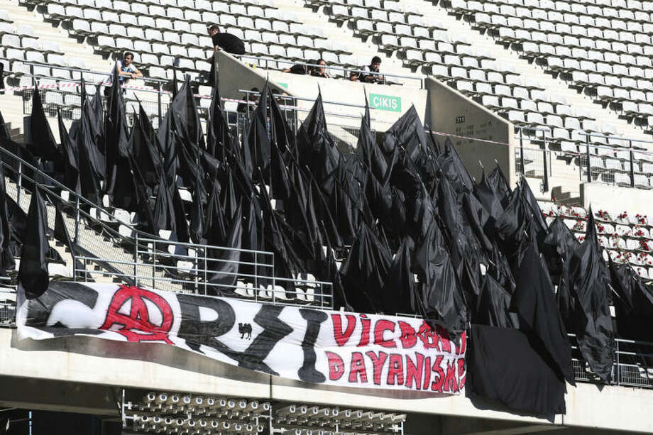 Supporters of Besiktas stand black flags to express their condolences for the victims of Soma mine accident before their Turkish League match in Istanbul, Turkey, Saturday, May 17, 2014. Turkey's Energy Minister Taner Yildiz said Saturday that crews had found more bodies overnight, raising the death toll to 301. An explosion and fire at a coal mine in Soma, some 250 kilometers (155 miles) south of Istanbul, killed hundreds of workers in one of the worst mining disasters in Turkish history. (AP Photo)