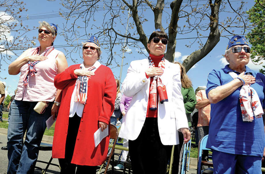 Members of the Norwalk VFW Auxillary, Joan Thant, Lynne Renzulli, Carol Jacobson and Marge Grindstaff at the the Shea-Magrath Memorial Ceremony Sunday at Calf Pasture Beach. Hour photo/Matthew Vinci