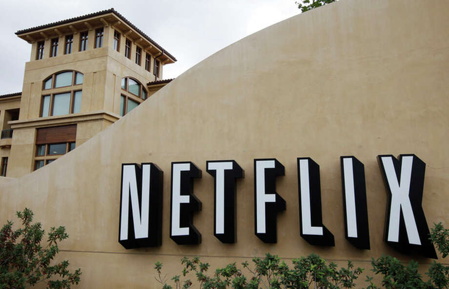 In this Oct. 10, 2011, file photo, the exterior of Netflix headquarters is seen in Los Gatos, Calif. Netflix stock, on Thursday, Jan. 24, 2013, is on its way to its biggest one-day gain since the video subscription service went public more than a decade ago. (AP Photo/Paul Sakuma, file) / AP