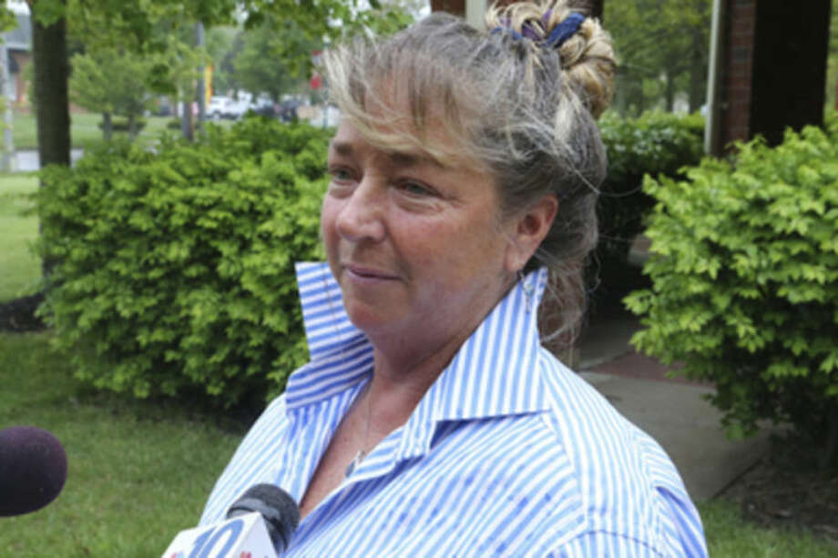 Bobcat owner Ginny Fine speaks with media after a judge allowed her to go home with her bobcat, Rocky, Friday, May 16, 2014 at Stafford Township Municipal Court, Stafford Township, NJ. The animal was removed from her home after it ran away twice and returned. (AP Photo/The Press of Atlantic City, Edward Lea)