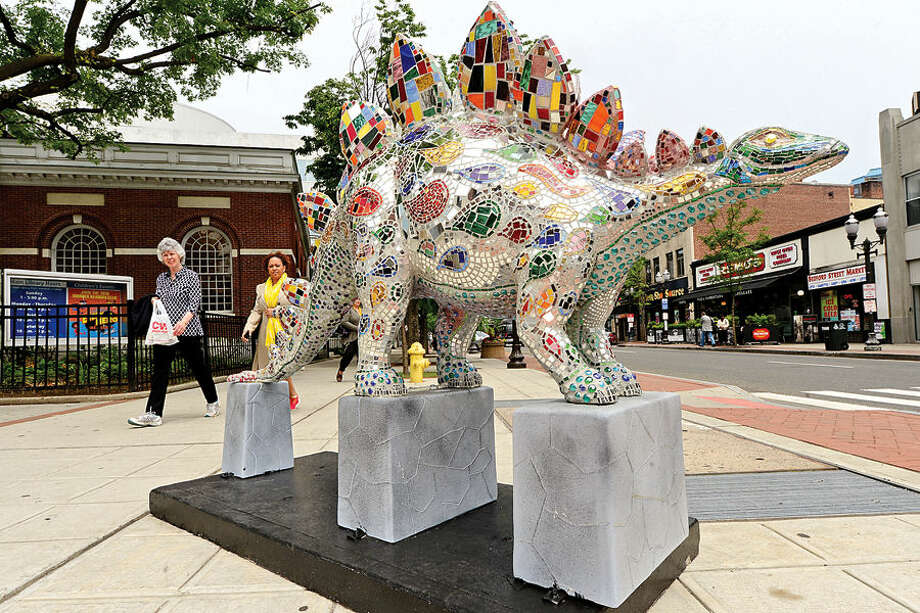 Stamford Downtown hosts its annual outdoor sculpture exhibit, Art in Public Places, featuring Dinosaurs Rule! that consists of 40 originally designed and painted fiberglass dinosaurs including Starosaurus created by artist Shelita Birchett Benash on display in front of The Ferguson Library.