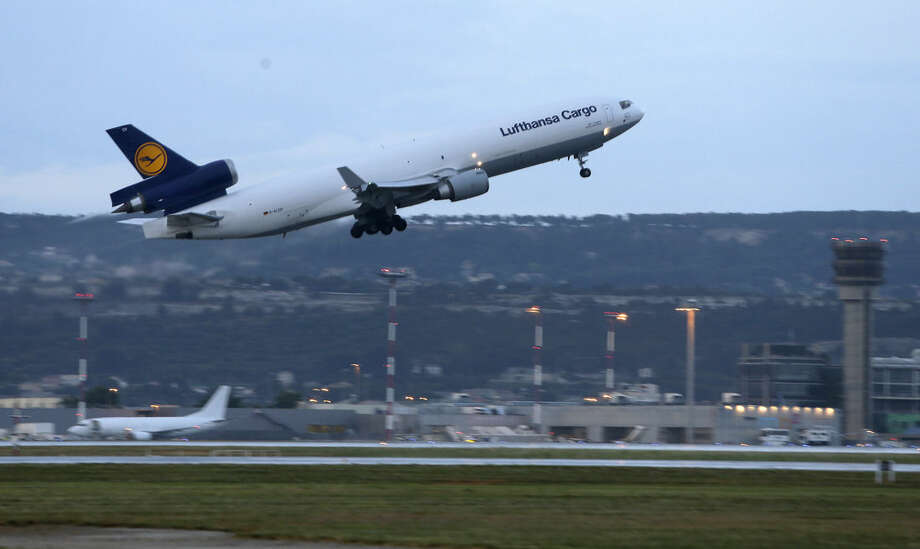 A Lufthansa plane carrying the coffins of the victims of Germanwings aircraft crash takes off from Marseille airport, southeastern France, Tuesday, June 9, 2015. After months of waiting, families of the 150 people killed when a Germanwings plane smashed into the French Alps in March will finally start burying their loved ones as the airline's parent company begins sending home victims' remains. Lufthansa prepared Tuesday to ferry coffins with remains of 44 victims by cargo plane from Marseille, France, to Duesseldorf, Germany, where Germanwings flight 9525 from Barcelona was supposed to land March 24. Instead, authorities say, the co-pilot purposely slammed the plane into a mountainside. (AP Photo/Lionel Cironneau)