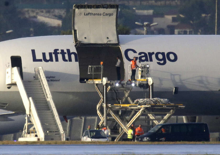Coffins of the victims of the Germanwings aircraft that crashed in the French Alps are loaded in a Lufthansa plane to transported in Duesseldorf, Germany, at Marseille airport southeastern France, Tuesday, June 9, 2015. After months of waiting, families of the 150 people killed when a Germanwings plane smashed into the French Alps in March will finally start burying their loved ones as the airline's parent company begins sending home victims' remains. Lufthansa prepared Tuesday to ferry coffins with remains of 44 victims by cargo plane from Marseille, France, to Duesseldorf, Germany, where Germanwings flight 9525 from Barcelona was supposed to land March 24. Instead, authorities say, the co-pilot purposely slammed the plane into a mountainside. (AP Photo/Lionel Cironneau)