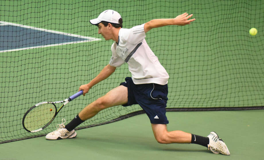 Hour photo/John Nash - Action from Tuesday's State Open Tennis Tournament semifinals at Yale University in New Haven.