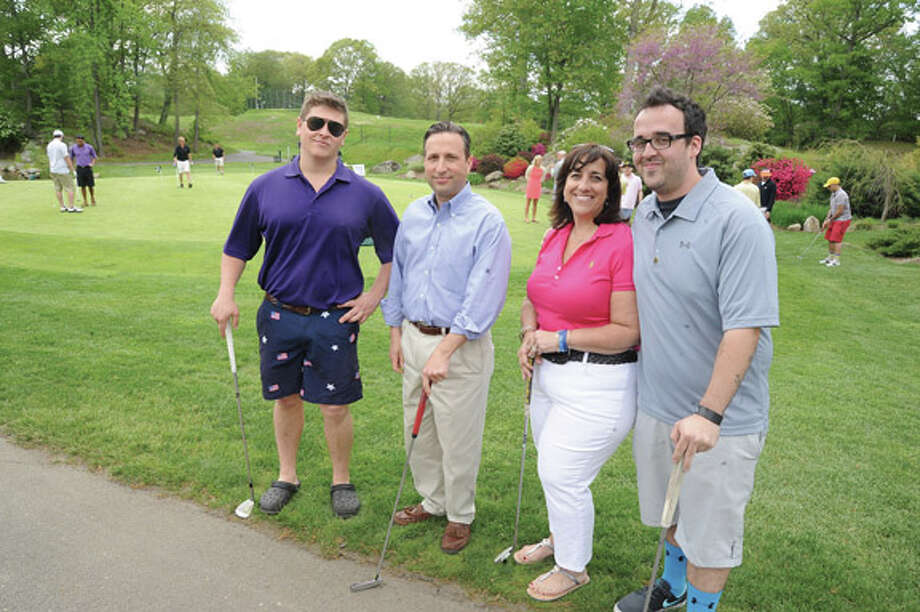 The Michael Ness Play it Foward golf tournament to benefit the Connecticut Burn Center Monday kicks of at Oak Hills Golf Course in Norwalk. From left, tournament co-chair John Scala III, State Senator Bob Duff, Michael's mother Liz Ness-Wobschall and his brotherMatt Ness.