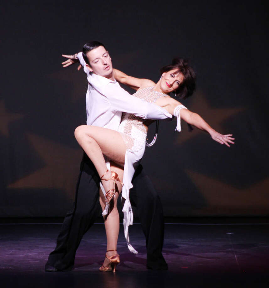 Stamford resident Lisa Maronian, owner of Sweet Lisa's Exquisite Cakes, winner of The Judges' ChoiceAwardat Curtain Cal's Dancing With The Stars event on May 17, seen here with her professional dance partner Ivan Angelkovski of Dance With Me Stamford.
