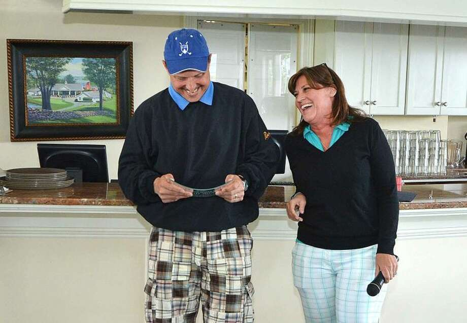 Hour Photo/Alex von Kleydorff Wally Dunn recives a plaque as he is honored on his retirement by Denise Vuoso