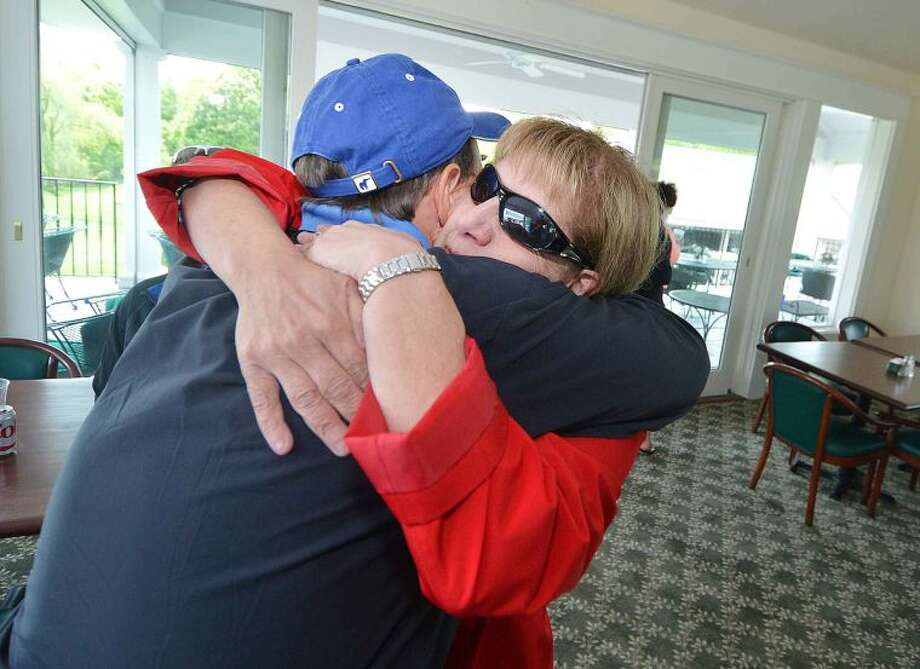 Hour Photo/Alex von Kleydorff Wally Hurd gets a hug from All Saints Principal Linda Dunn