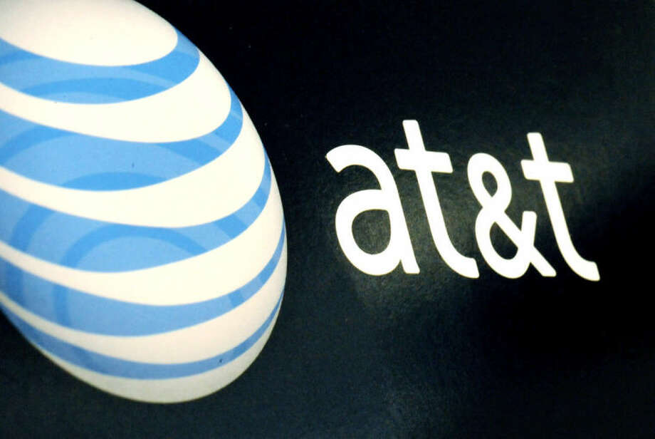 FILE - In this Oct. 19, 2009 file photo, the AT&T logo is on display at a RadioShack store in Gloucester, Mass. AT&T says it is buying DirecTV for $95 per share, or $49 billion, a move that gives the telecommunications company a larger base of video subscribers and increases its ability to compete against Comcast and Time Warner Cable, which agreed to a merger in February. (AP Photo/Lisa Poole, File)