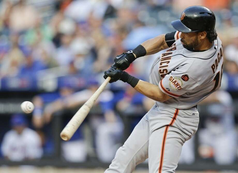 San Francisco Giants' Angel Pagan hits an RBI single during the first inning of a baseball game against the San Francisco Giants on Tuesday, June 9, 2015, in New York. (AP Photo/Frank Franklin II)