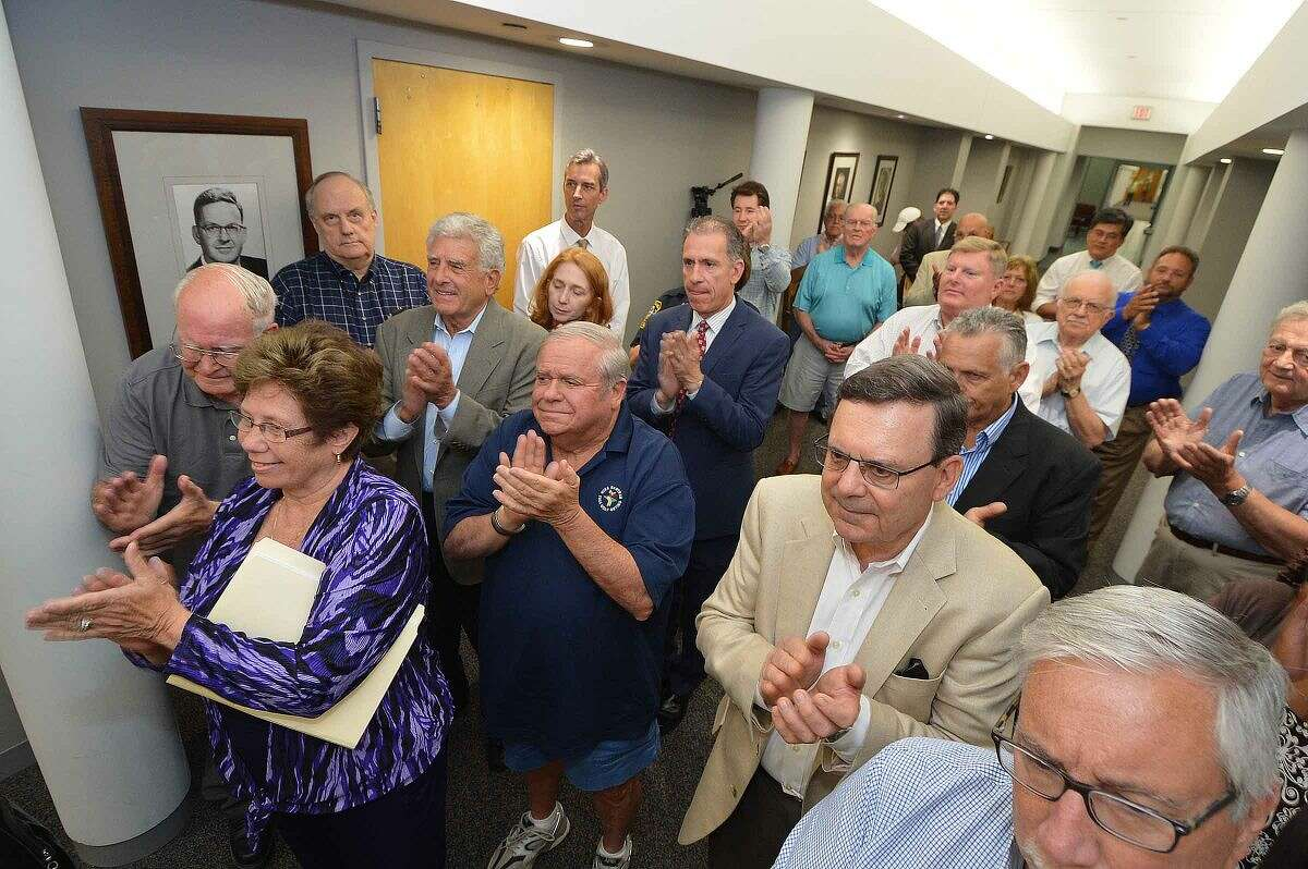 Hour Photo/Alex von Kleydorff Friends of Richard Moccia fill the hallway at the Mayors Portrait Gallery at City Hall