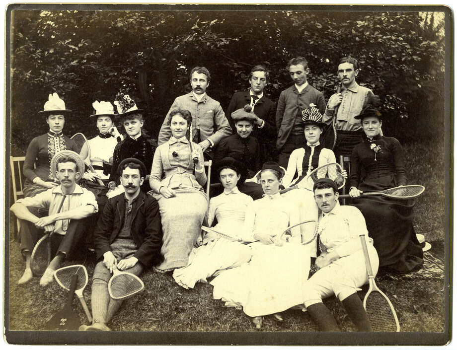 """This 1886 photo shows pioneering Victorian-era photographer Alice Austen, second row left, and others in a photo Austen shot using a remote shutter titled """"E.A. and Group on Tennis Ground."""" Austen's images often challenged social conventions and gender roles. The Alice Austen House museum on Staten Island in New York City is expanding its mission by championing tolerance and sending a contingent to march in New York's gay pride parade June 28. (Alice Austen House via AP)"""