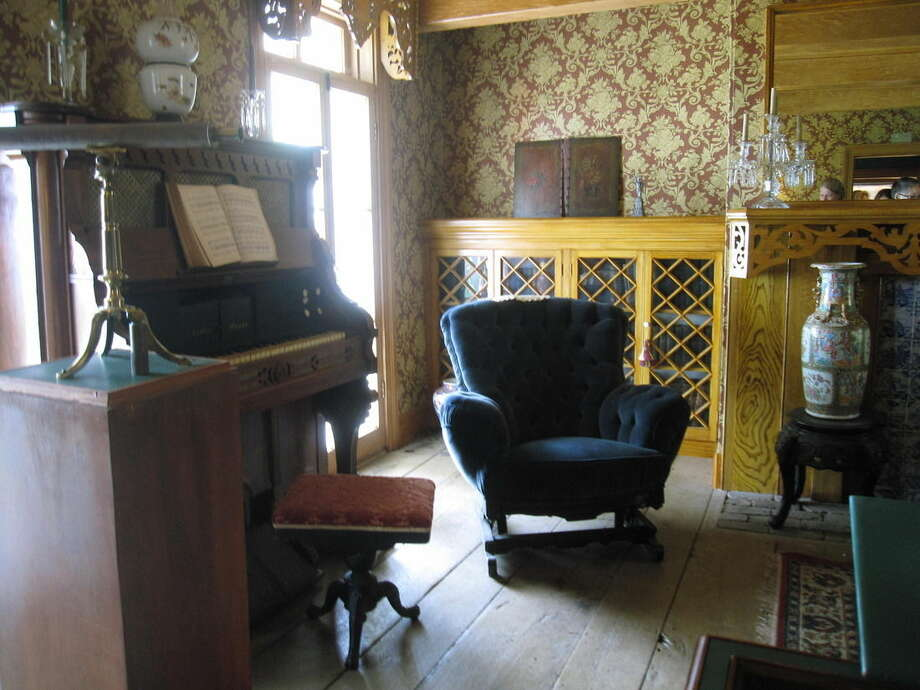 This October 2014 photo shows the interior of the Alice Austen House in the Staten Island borough of New York. Austen was a pioneering Victorian-era photographer whose images often challenged social conventions and gender roles. The museum is redefining its mission by championing tolerance and sending a contingent to march in New York's gay pride parade June 28. (AP Photo/Beth J. Harpaz)